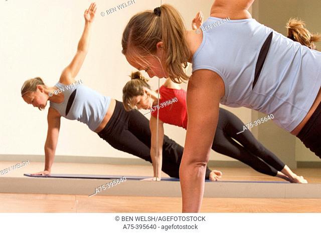 women doing pilates exercise
