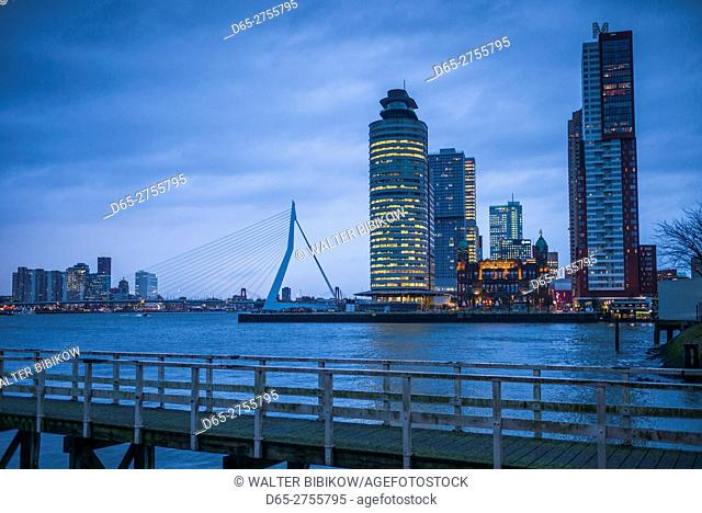 Netherlands, Rotterdam, new commerical towers of renovated port district, dusk