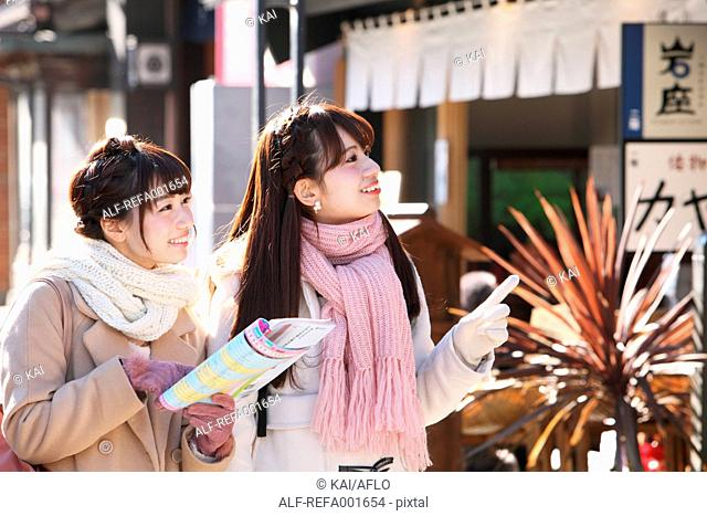 Young Japanese women enjoying trip in Kawagoe, Japan