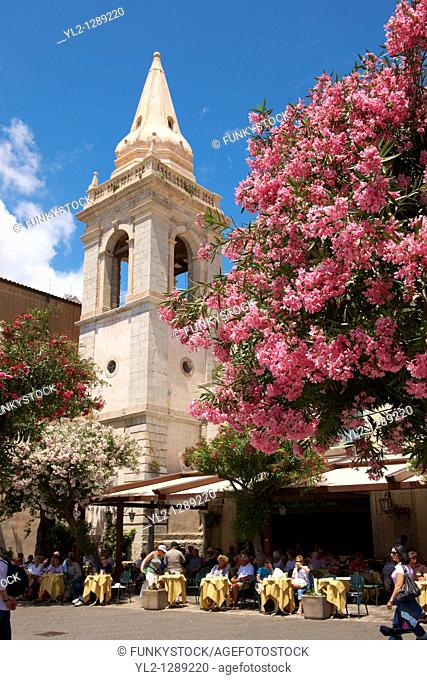 Cafe and church of St  Guiseppe on the Plaza ix Aprile with trees in blossom - Taormina, Sicily