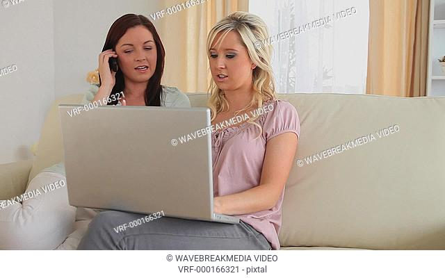 Women with a laptop and a cellphone