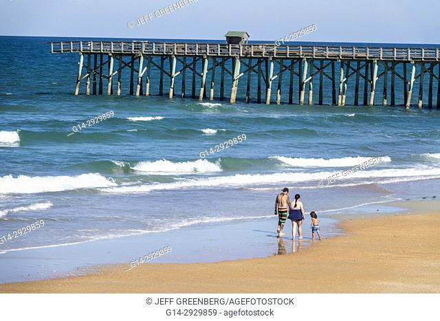Florida, Flager Beach, Atlantic Ocean, water, sand, waves, fishing pier, family, beachcombing, boy, son, parents, father, mother