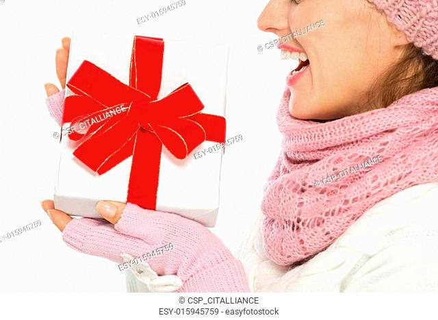 Closeup on Christmas present box in hand of woman in winter clothing