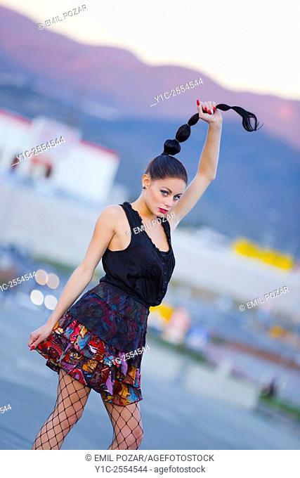 Pretty teen girl pulling hair