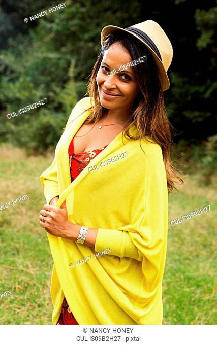 Portrait of mature woman, outdoors, smiling