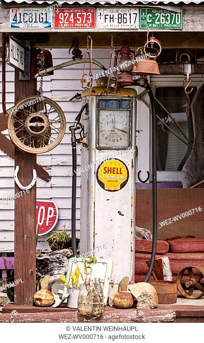 New Zealand, South Island, Ross, view to an old petrol pump and other decoration in front of a house