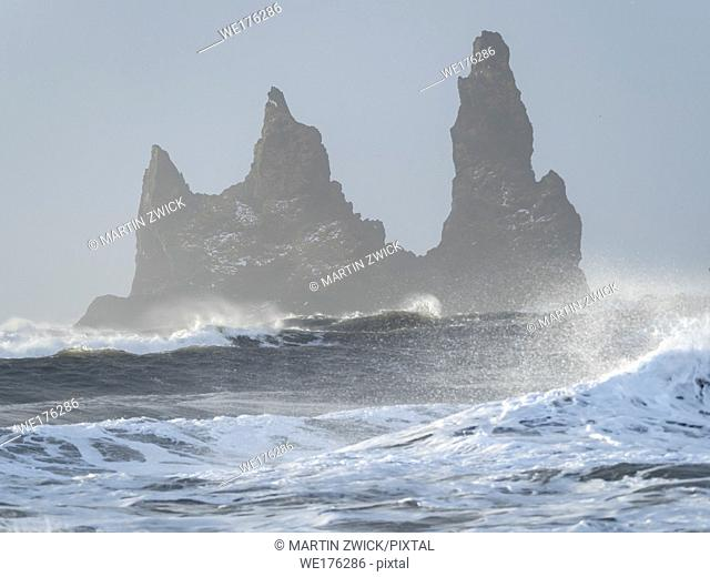 The coast of the north atlantic near Vik y Myrdal during winter. The sea stacks Reynisdrangar. Europe, Northern Europe, Scandinavia, Iceland, February