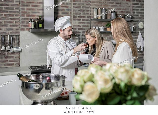 Chef with two women in kitchen