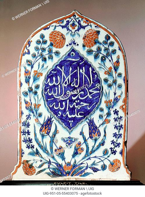 A tombstone shaped tile, possibly made for a mausoleum, bearing the creed there is no God but God, Muhammad is his prophet, may God show mercy to him