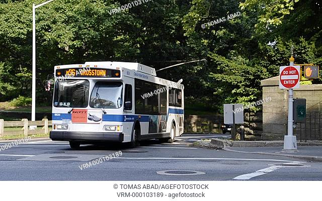 MTA public bus traversing central park via Central Park, New York City