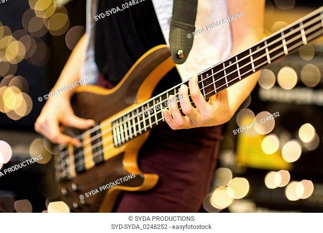 close up of musician with guitar at music studio