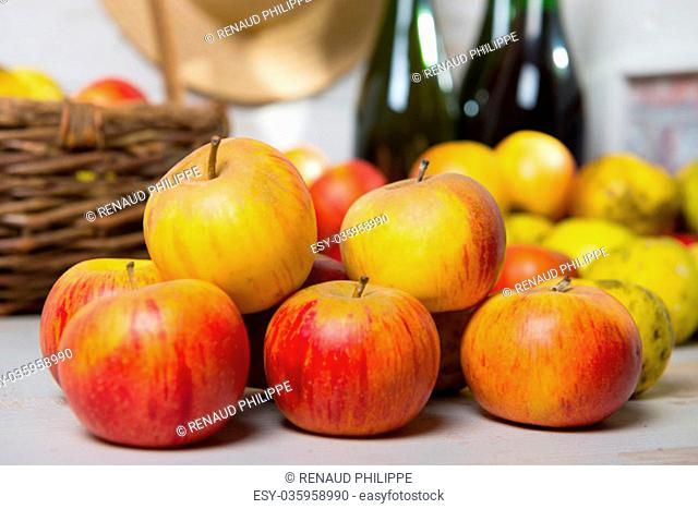 composition of organic fresh apples with a bottle of Normandy cider