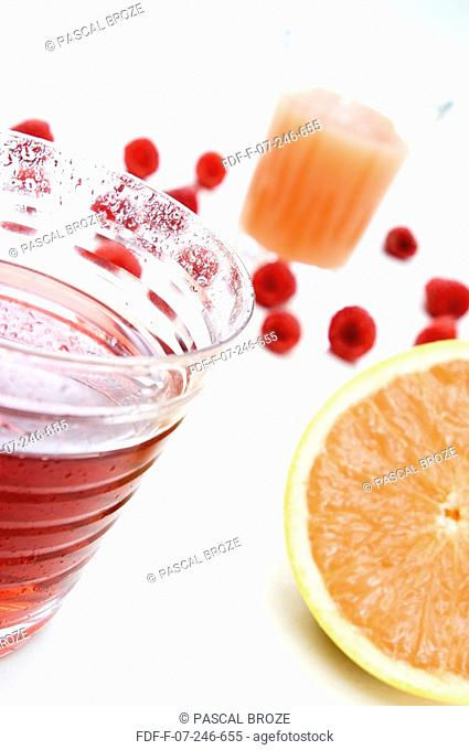 Close-up of two glasses of grapefruit juice and raspberry juice
