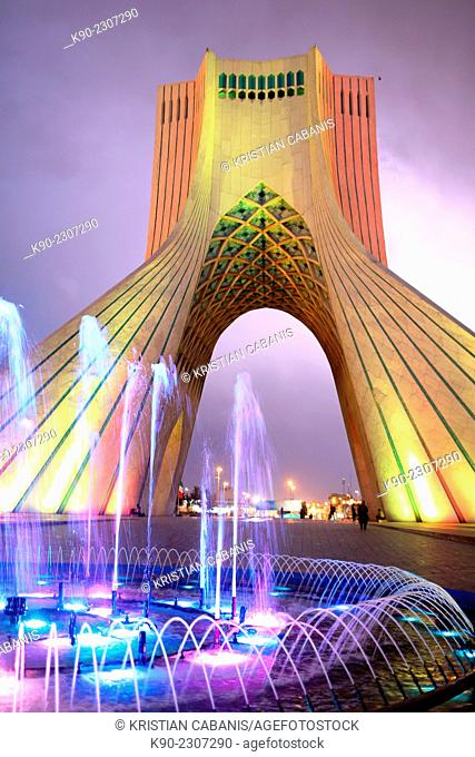 Azadi Tower with a blue fountain in the foreground, Borj-e Azadi, Tehran, Iran, Asia