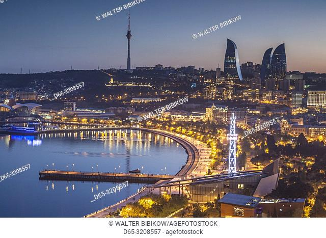 Azerbaijan, Baku, high angle city skyline, from the north, dusk