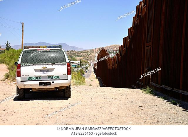 A metal wall indicates the international boundary between Nogales, Arizona, USA, and Nogales, Sonora, Mexico, as seen from Arizona