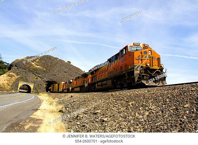 A BNSF mixed manifest freight train at Tunnel 2 near Drano Lake, Washington, USA