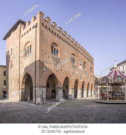 "view of medieval bricks palace """"Cittànova"""" in city center, shot in bright winter light at Cremona, Lombardy, Italy"