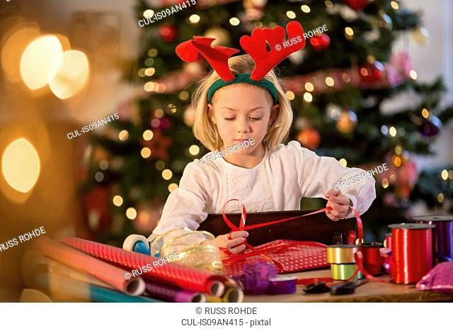 Girl wrapping Christmas presents