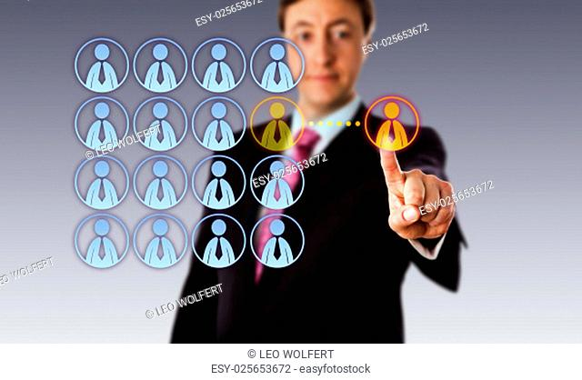 Smiling manager is touching a single male white collar worker icon outside an organized group of male employee icons. Business metaphor for outsourcing