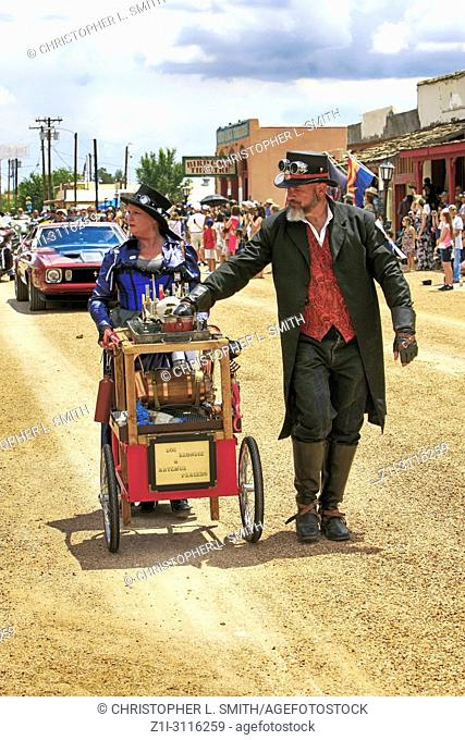 Man and woman dressed as Flim-flam snake oil sales people at the annual Doc Holiday parade in Tombstone, Arizona