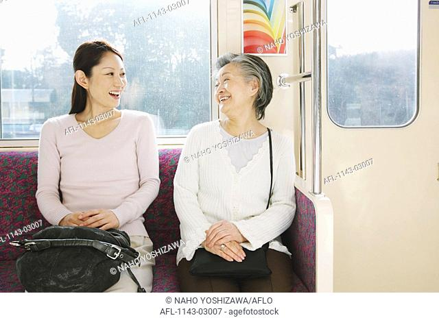 Two people traveling on a train