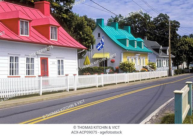 Houses in summer along Route 368 in the village of Saint-Jean on Île d'Orléans in the St  Lawrence River, Quebec, Canada