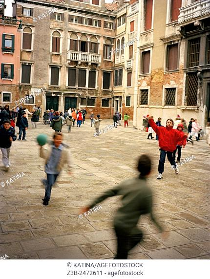 Children playing dodgeball at school, Venice, Veneto province, Italy, Europe