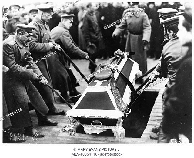 Lowering a coffin into a grave at the 'Fallen Hero's' funeral in the Field of Mars