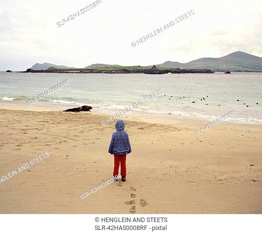 Girl standing on empty beach