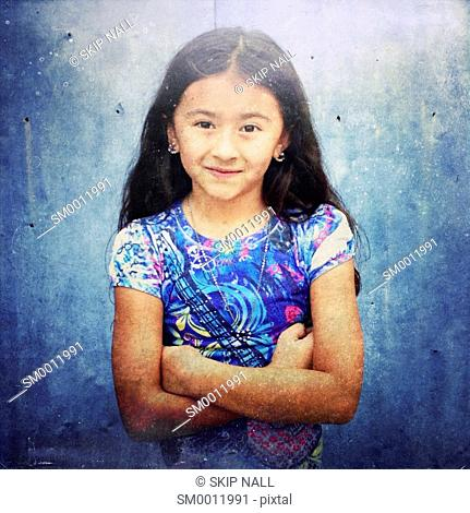 Young girl smiling and looking at camera