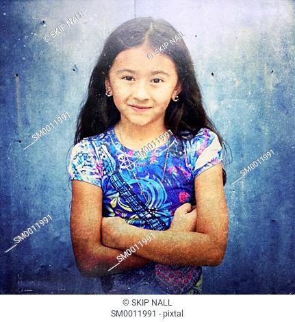 Young girl smiling and looking at camera