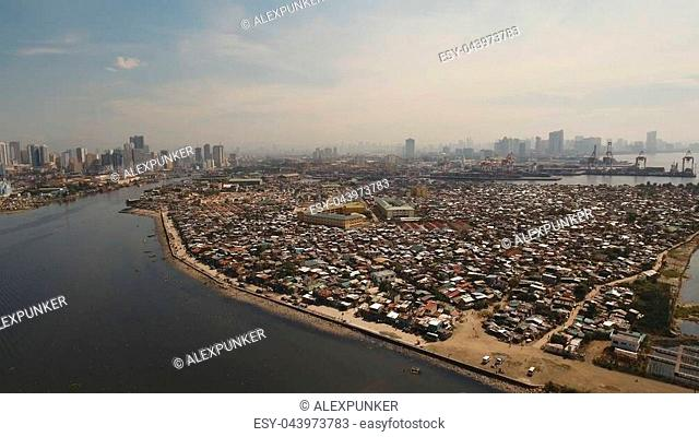 Aerial view skyline of Manila city. Fly over city with skyscrapers and buildings. Aerial skyline of Manila . Modern city by sea, highway, cars, skyscrapers