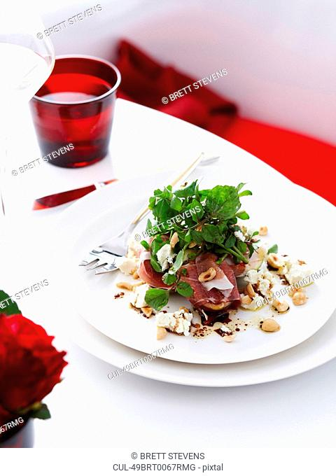 Plate of figs with prosciutto and nuts