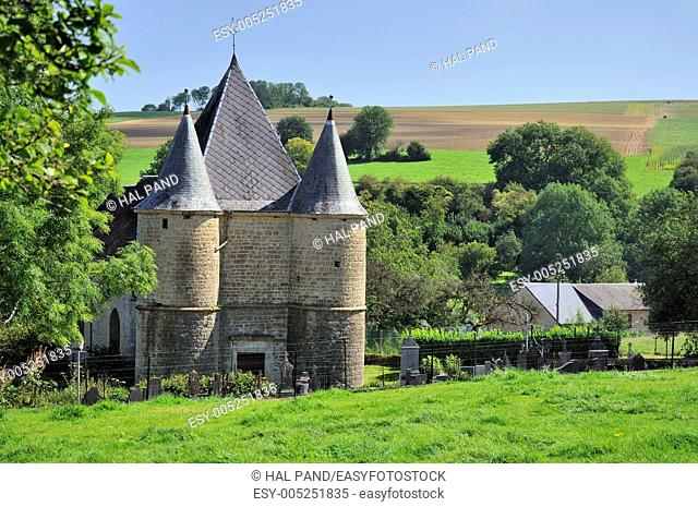 fortified church in hilly countryside shot in bright summer light