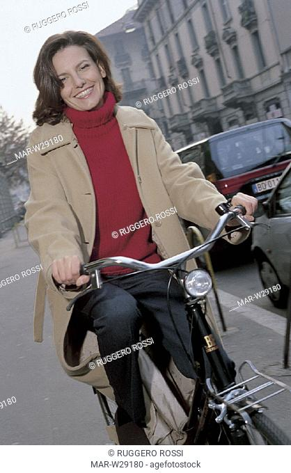 woman riding bicycle in the town