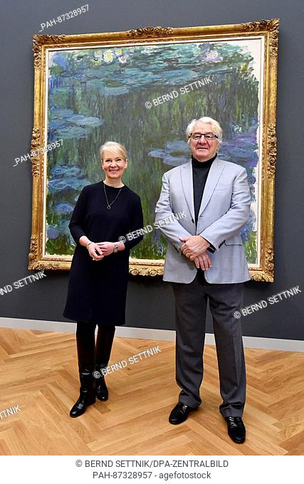 Art patron Hasso Plattner and museum director Ortrud Westheider stand in front of the painting 'Sea Roses' by Claude Monet at the Museum Barberini in Potsdam