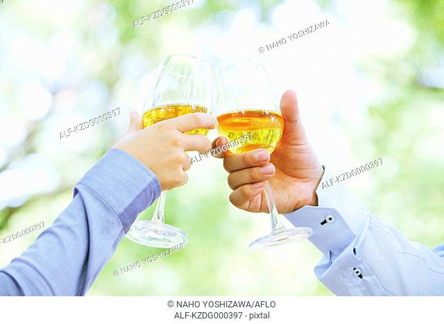 Couple cheering with white wine