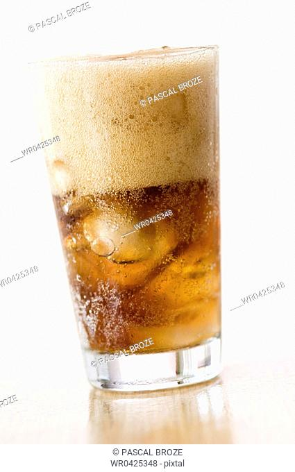 Close-up of ice cubes inside a glass of cola