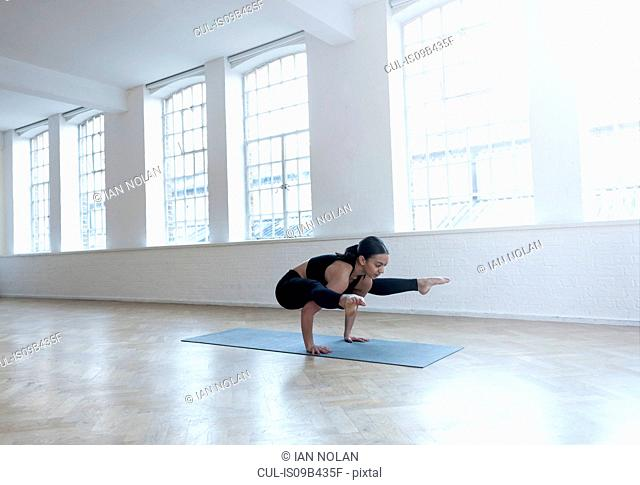 Woman in dance studio in yoga position