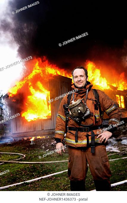 Fire fighter in front of burning buildings