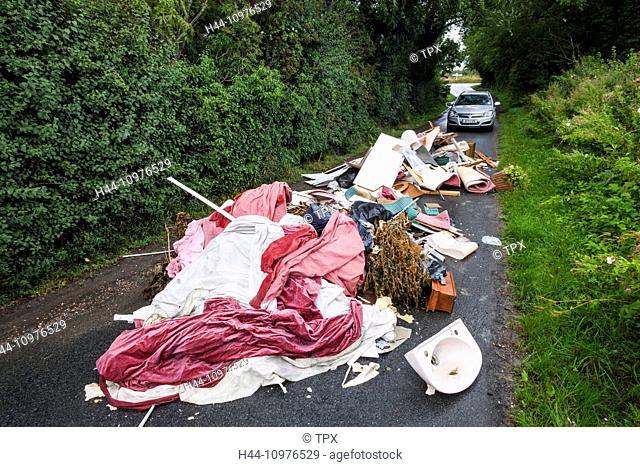 England, Sussex, Fly Tipping on Small Rural Road