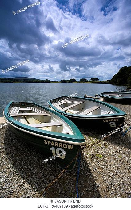 England, Cumbria, Talkin Tarn Country Park, Rowing boats on the shore of the Talkin Tarn near Carlisle