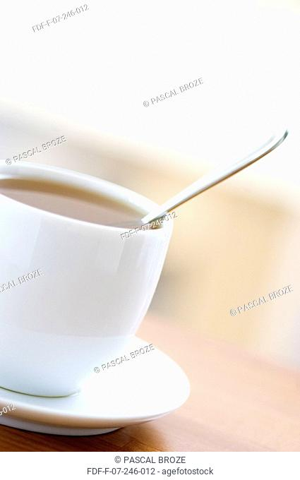 Close-up of a teaspoon in a cup of herbal tea