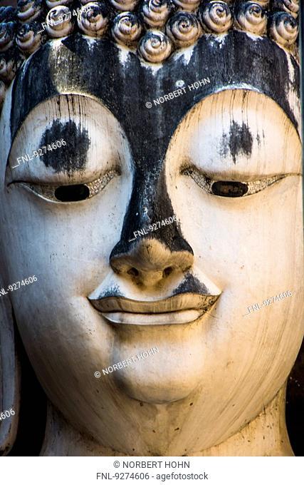 Buddha statue in Temple Wat Si Chum in historic park of Sukhothai, Thailand