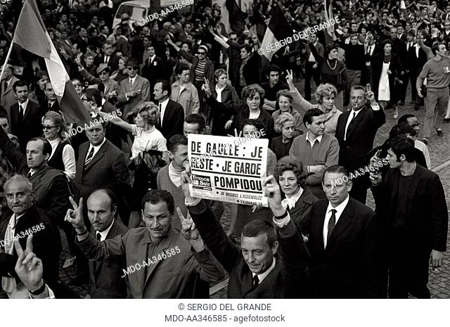 The risk of a revolution in Paris has been averted. A demonstrator is showing a special edition of 'France Soir' announcing that Charles de Gaulle and Georges...