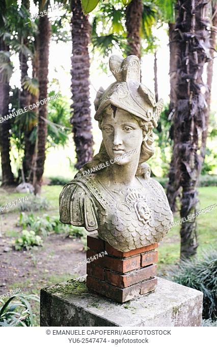Half-length statue in the garden of an old villa, Lombardy, Italy