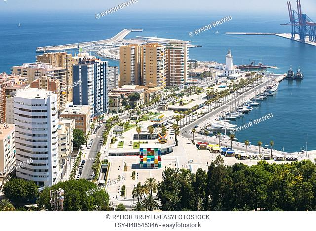 Cityscape aerial view of Malaga, Spain. Lighthouse and marina