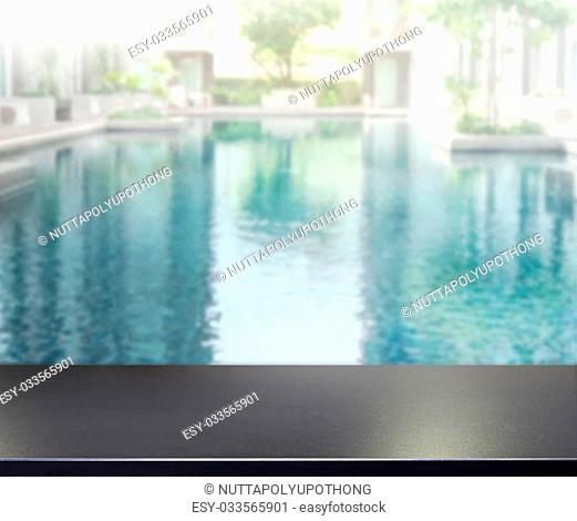 Wood Table Top of The Background and Pool