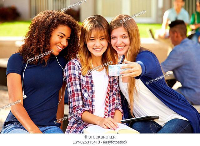 Female High School Students Taking Selfie On Campus